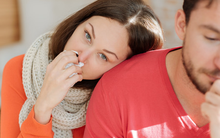 hanky: Young couple suffering from pain at home