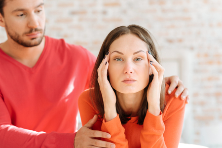 mindful: Mindful man taking care about his girlfriend at home Stock Photo