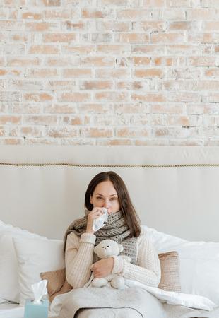 powerless: Powerless woman suffering from flu in the bedroom