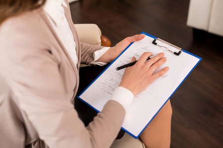Close up of psychologists notes Stock Photo