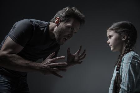 threaten: Dependent on alcohol man threaten her daughter Stock Photo