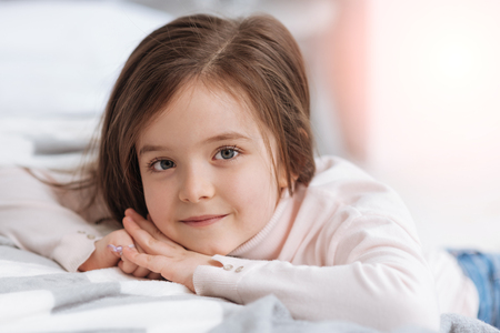 upbringing: Positive beautiful girl smiling