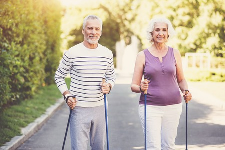 keeping fit: Cheerful elderly couple keeping fit