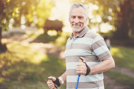 Delighted well built man enjoying his walk Stock Photo