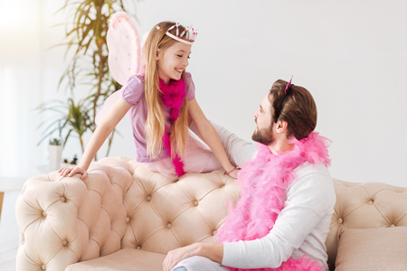upbringing: Little fairy sitting Stock Photo