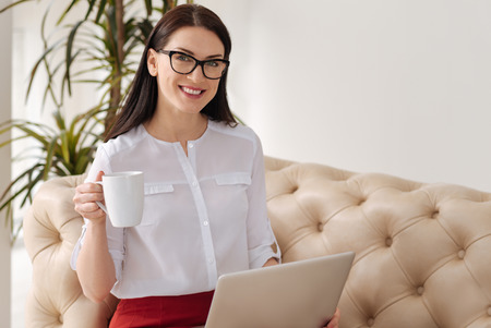 self employed: Joyful self employed woman looking at you Stock Photo