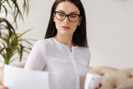 self employed: Thoughtful self employed woman being involved in her work Stock Photo