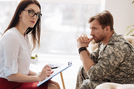 Good looking attractive psychologist working with a military man