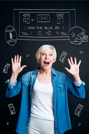 and guessing: Joyful aged woman guessing the right score Stock Photo