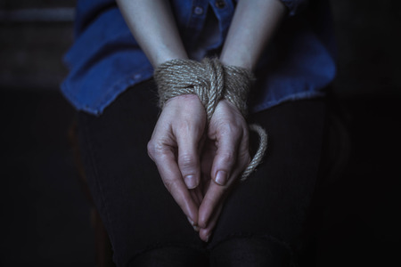 Helpless young woman with her hands tied 스톡 콘텐츠