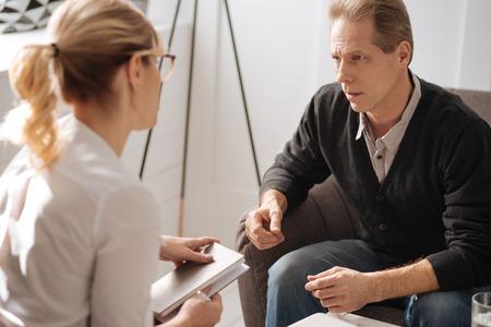 Depressed pessimistic man sharing his problems