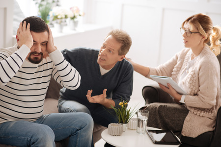 Unhappy emotional man having a quarrel with his boyfriend Stock Photo