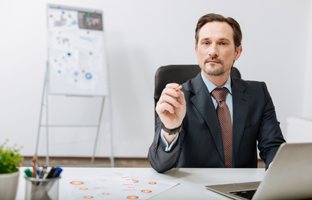 Confident recruiter performing his responsibilities in the office Stock Photo