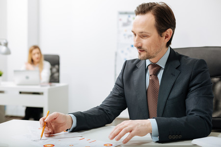 Involved businessman working with documents in the office