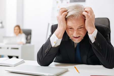 leadership potential: Desperate aged employer expressing anger in the office