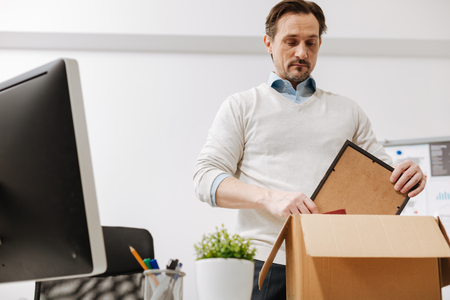 lamentable: Lamentable staff member packing the box and leaving the office