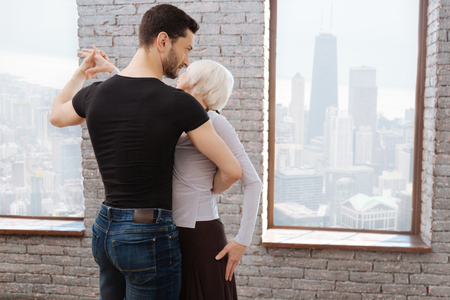 Mature skilled dancer teaching aged woman at the ballroom