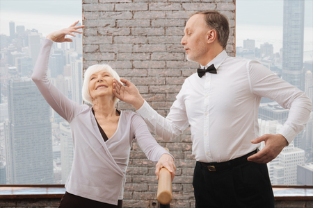 Artistic funny pensioners performing in the dance studio