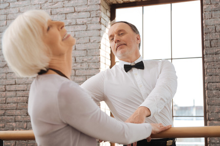Romantic pensioners dancing in the dance studio Stock Photo
