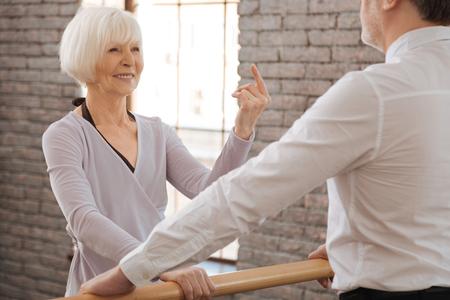 Joyful aged dance couple acting in the dance studio
