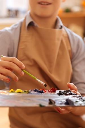 Enthusiastic child having art lesson at school Stock Photo