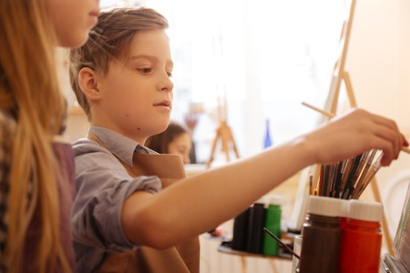 Involved kids practicing painting in the art studio