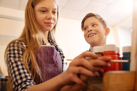Delighted children enjoying painting in the art studio Stock Photo