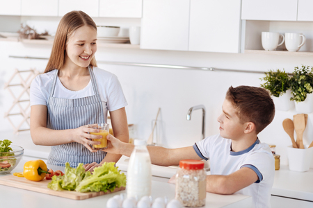 Cheerful siblings having a healthy breakfast