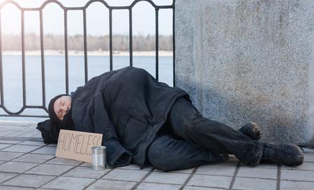 Untidy man sleeping in the street Stock Photo