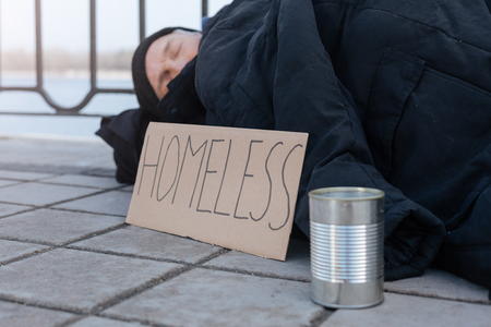 untidy: Side view photo of homeless person while resting
