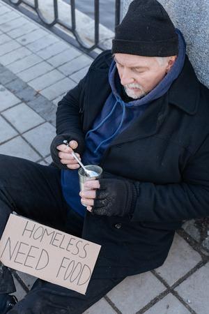 Homeless man wearing cozy cap