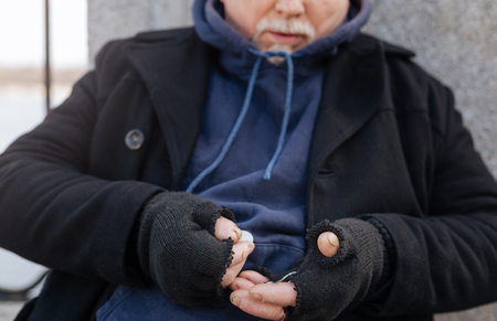 prejudice: Old bearded male person collecting coins
