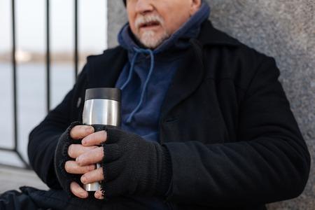 Upset man leaning on concrete column
