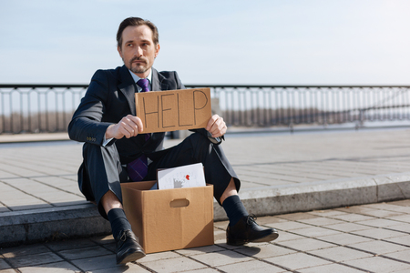 prejudice: Jobless male person asking for help Stock Photo