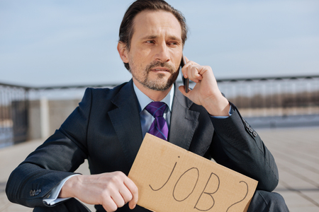 Portrait of enigmatical male looking for better job Stock Photo