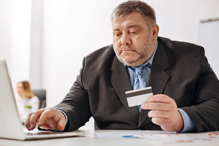 checking account: Chubby office worker buying things online