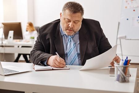 job deadline: Frontline company employee focused on the task Stock Photo