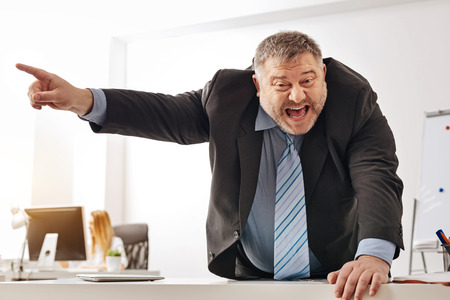 Stressed out employee shouting at his fellow office worker