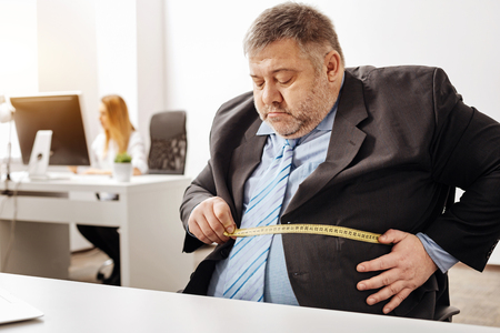 Hardworking employee suffering from excess weight