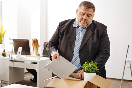 Sad distressed office worker getting fired
