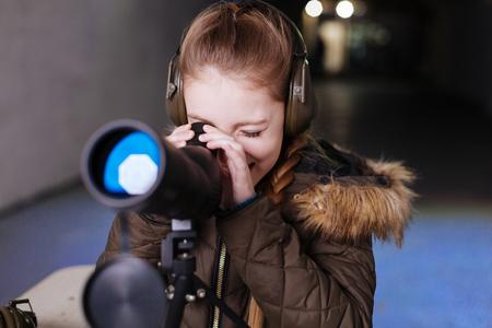 Nice cheerful girl wearing headphones Stock Photo