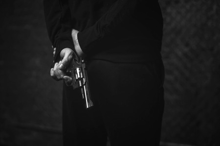 cinematic: Furious brutal criminal planning a robbery Stock Photo