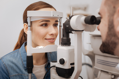 Beautiful attractive woman visiting an ophthalmologist