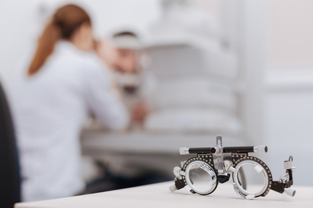 Selective focus of eye test spectacles lying on the table
