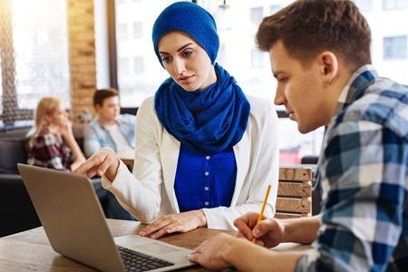 genomics: Nice muslim woman studying with her groupmates