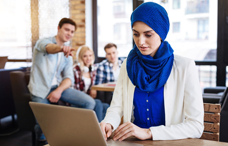 Muslim woman sitting in the cafe