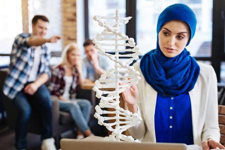 Muslim girl studying genetics