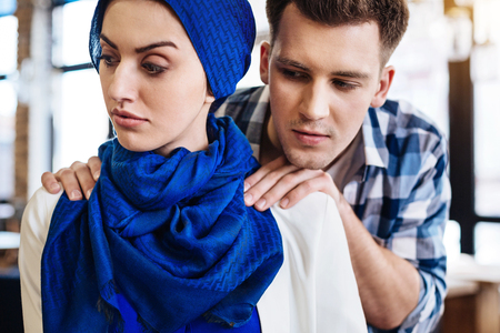 inappropriate: Attractive muslim woman experiencing humiliation from a man