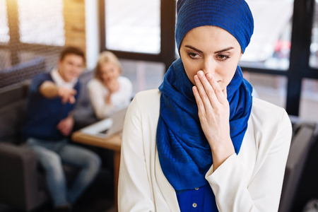 Depressed muslim woman feeling humiliated