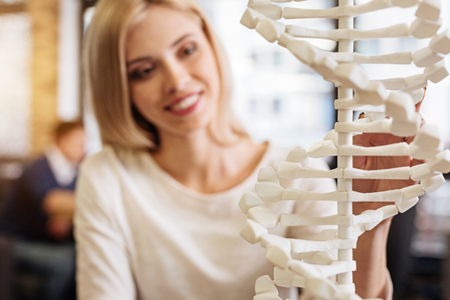 Cheerful smiling student holdign DNA model Stock Photo